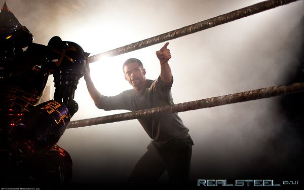 click to free download the wallpaper--Hugh Jackman in Real Steel in 1920x1200 Pixel, Pointing the Way, the Robot is Supposed to Listen to Him - TV & Movies Wallpaper