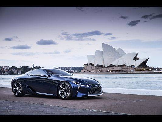 Image of Cars - A Blue Lexus Car by Seaside, the Blue Sky, Combine an Incredible Scene