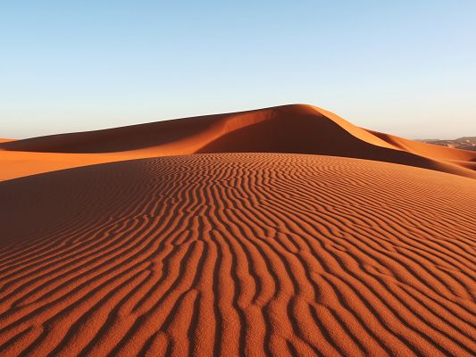 Image of Natural Landscape, Sand Dunes with Its Ups and Downs, the Blue Sky