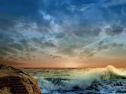 click to free download the wallpaper--Images of Nature Landscape, the Twisting Sea, the Blue Sky, Is Rain About to Fall?