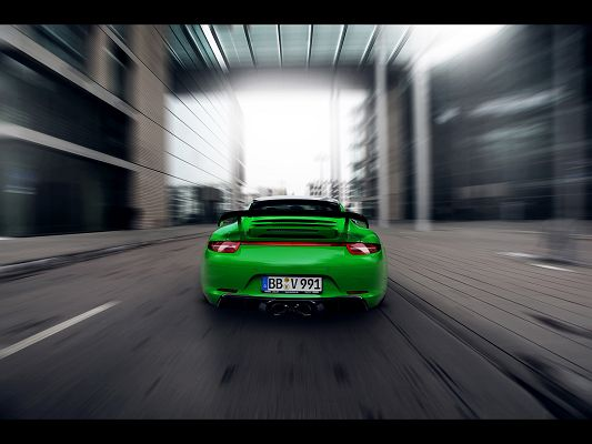 Images of Super Car, Green Porsche 911 in the Sun, Seen from Back and Surrounding Scene, Speed is Incredible