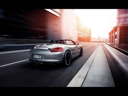 click to free download the wallpaper--Images of Super Cars, Porsche Boxster Seen from Motion Rear, is Looking Good