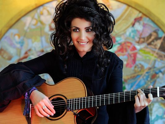 click to free download the wallpaper--In Black Dress and Hair, Playing with Guitar, Wonderful Tone is Produced, She is Like a Glowing Musical Spirit - HD Katie Melua Wallpaper