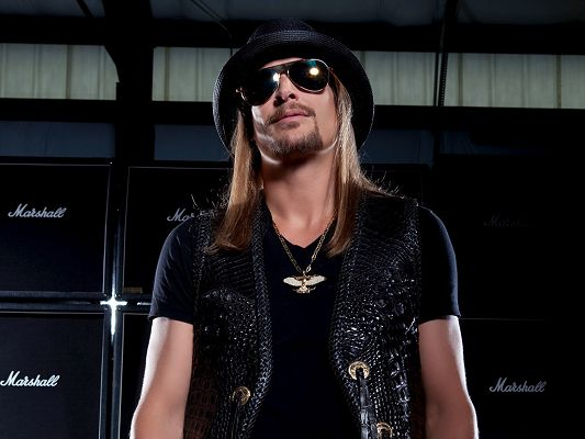 click to free download the wallpaper--In Black Suit, Glasses and Hat, Combined with Beard, He Looks Indeed Awesome and Artistic - HD Kid Rock Wallpaper