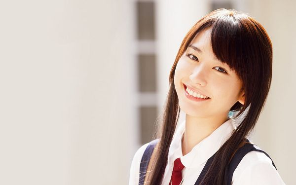 click to free download the wallpaper--In Black and Straight Hair, Sunlight is Pouring on Her, Smiling Facial Expression and Schoolsuit, It is Good to be Young - HD Yui Aragaki Wallpaper