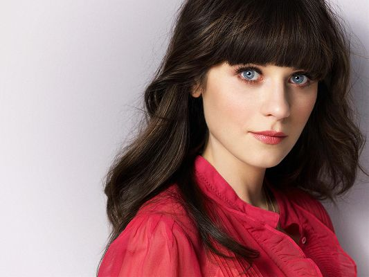 click to free download the wallpaper--In Red Skirt and Peaceful Facial Expression, Your World Will be More Wonderful with Her - HD Zooey Deschanel Wallpaper