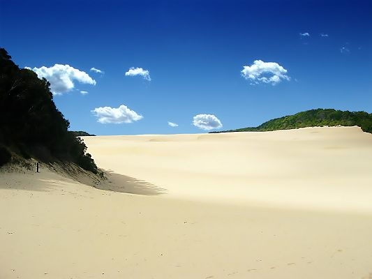 click to free download the wallpaper--Incredible Nature Landscape, the Sand Sea, the Blue and Mirror-Like Sky