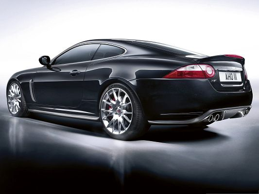 Jaguar Car Wallpaper, Black Supercar with Smooth Lines, Flat Road