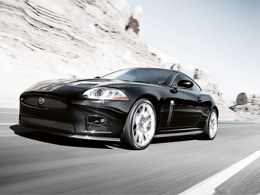 click to free download the wallpaper--Jaguar Car as Background, Black Super Car Running by Hillside, Incredible Speed