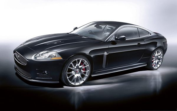 click to free download the wallpaper--Jaguar Car as Background, Black and Decent Car in Stop, Glowing Body