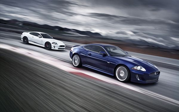 Jaguar XKR Post in Pixel of 1920x1200, Two Cars Running in Prerry Full Speed, Enjoy Your Drive in the Flat and Stright Road - HD Cars Wallpaper
