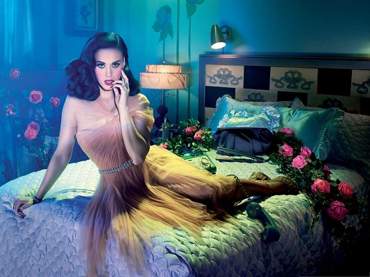 click to free download the wallpaper--Katy Perry Poster, Lying on Big Bed, Pink Flowers All Around Her, Appealing Pose
