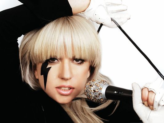 click to free download the wallpaper--Lady Gaga Image, Microphone Held in Hand, Lightning on the Face