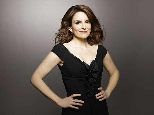 click to free download the wallpaper--Lady in Black Tight Dress, Skin is Snowy White, Smiling Face Declares Her a Confident Woman - HD Tina Fey Wallpaper
