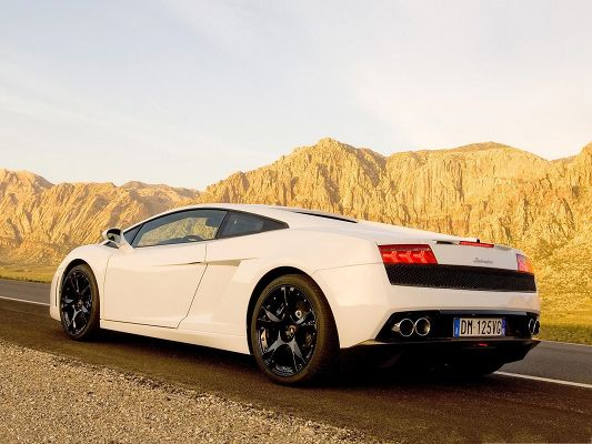 click to free download the wallpaper--Lamborghini Sport Cars, White and Decent Car on a Slope, Impressive Look