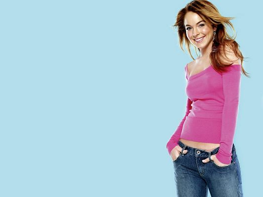 Lindsay Lohan HD Post in Pixel of 1600x1200, Hair is Dancing Due to the Blow, Simple Light Blue Background, is Impressive and Fit - TV & Movies Post