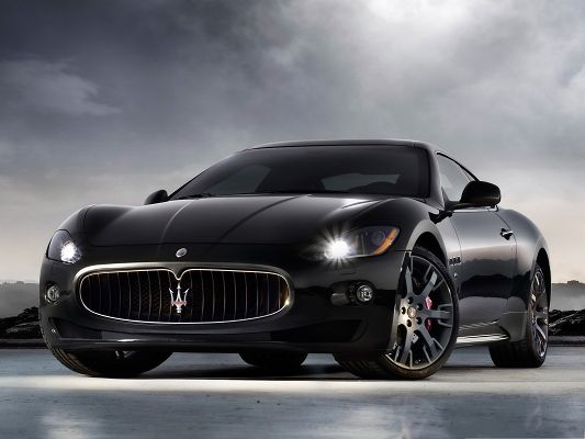 click to free download the wallpaper--Maserati Car Wallpaper, Black Super Car Turning a Corner, Like the King