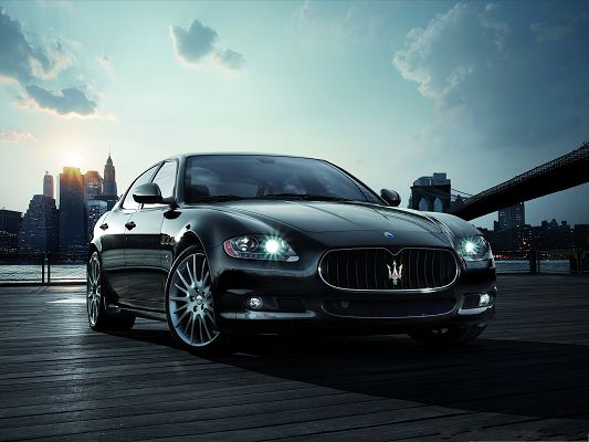 Maserati Car Wallpaper, Black and Decent Car Turning a Corner, the Rising Sun