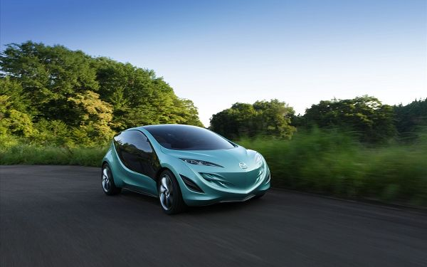 click to free download the wallpaper--Mazda Sky Concept 3 Post in Pixel of 1920x1200, Light Blue Car on the Move, Is It Ignorant of the Natural Scene? - HD Cars Wallpaper