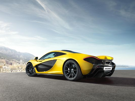 click to free download the wallpaper--McLaren P1 Supercar 2014, Yellow and Decent Car in Front of the Sea