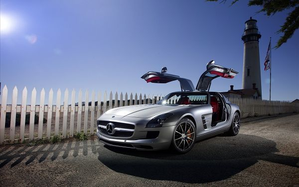 click to free download the wallpaper--Mercedes Benz SLS AMG HD Post in Pixel of 1920x1200, a Stopping Car by White Fences' Side, All Are Decent and Good-Looking, a Great Fit - TV & Movies Post