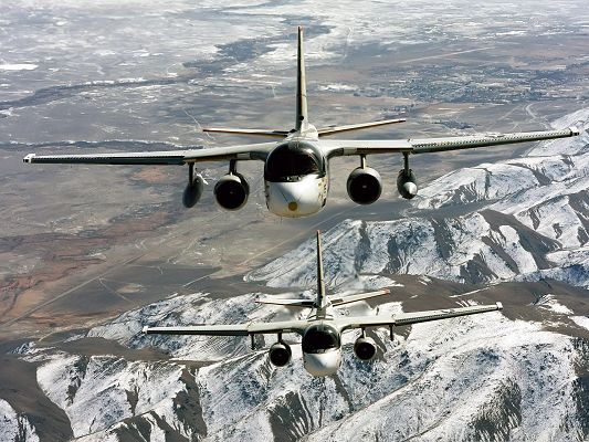 click to free download the wallpaper--Military Airplanes Wallpaper, War Planes Flying Over Snow-Capped Mountains