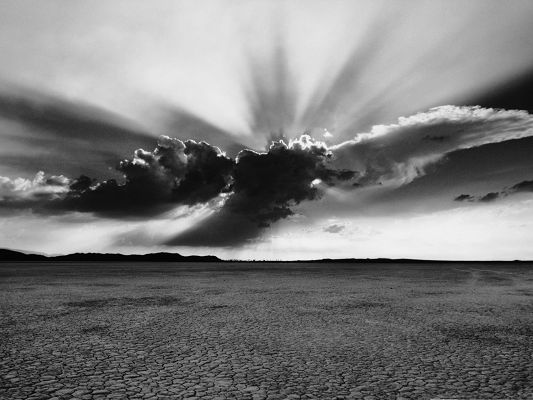 Monochrome Landscape Photography, the Sun Breaking Thick Clouds, Will Make Its Way Out