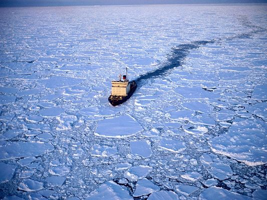 click to free download the wallpaper--Natural Landscape Images, a Boat in the Run, Working as Ice Breaker