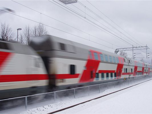 click to free download the wallpaper--Natural Scenery Images, Helsinki Train on Fast Move, Snow is Everywhere
