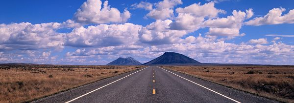 click to free download the wallpaper--Natural Scenery Wallpaper - A Wide and Straight Road, the Blue Sky Decorated with White Clouds, Amazing Driving Experience