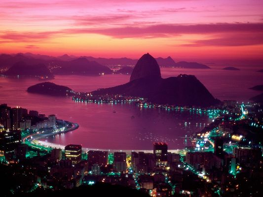 click to free download the wallpaper--Nature Landscape Image, Sugarloaf Mountain, the Pink Sky, Bright Lights, Romantic and Warm Scene