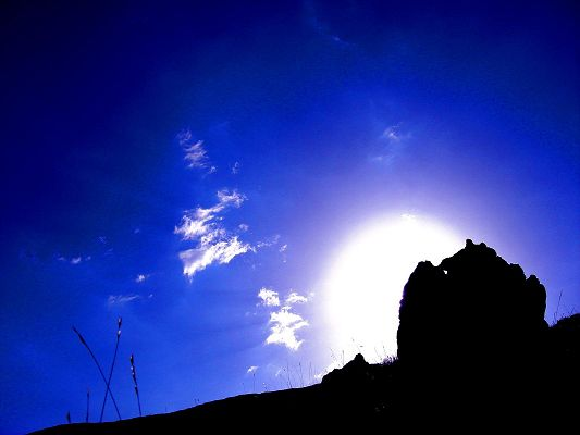 click to free download the wallpaper--Nature Landscape Pics, the Rising Sun, the Blue and Cloudless Sky, Black Stones
