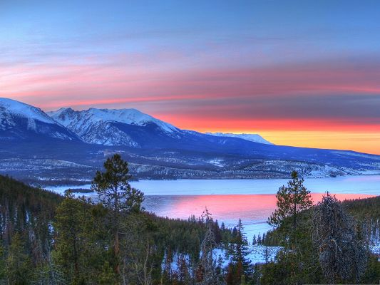 Nature Landscape Picture, Snow-Capped Mountains Along the Peaceful Lake, the Setting Sun