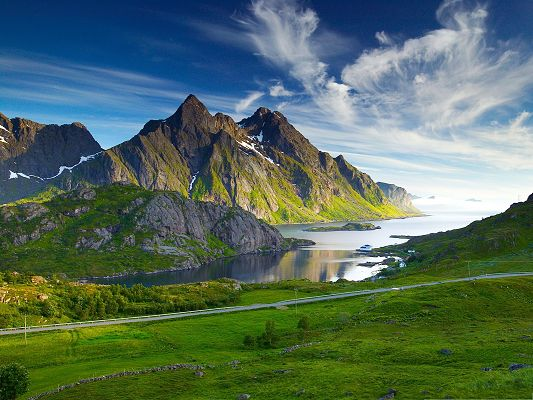 click to free download the wallpaper--Nature Nordic Landscape, Tall Mountains and the Peaceful Sea, Green Grass Alongside
