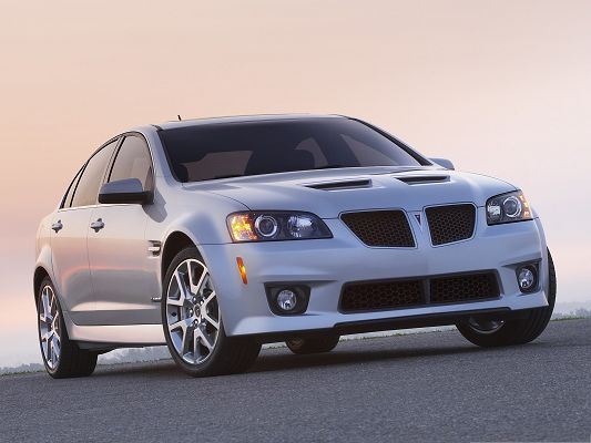 click to free download the wallpaper--Nice Car Images as Wallpaper, Pontiac G8 GXP Car Turning a Corner
