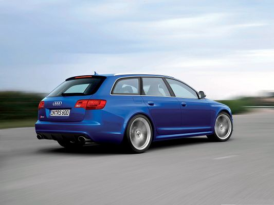 click to free download the wallpaper--Nice Cars Picture, Blue Audi RS6 Avant Car in Fast Speed, Under the Blue Sky