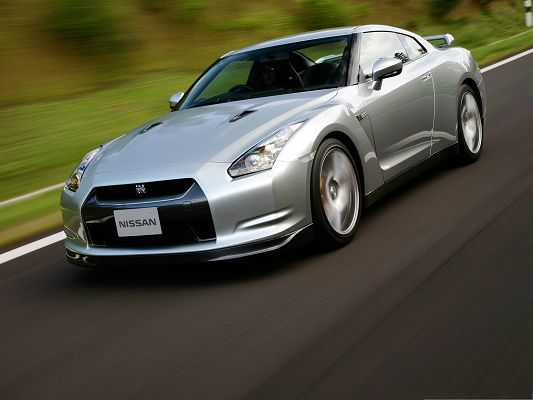 click to free download the wallpaper--Nissan GT Car Wallpaper, Super Car Running in Incredible Scenery