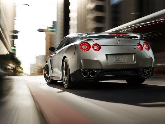 click to free download the wallpaper--Nissan GTR Car, Gray Car Turning a Corner, Give the Shinning Car a Way
