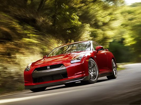 click to free download the wallpaper--Nissan GTR Car as Background, Red Car in the Run, Dizzy Green Scene Around