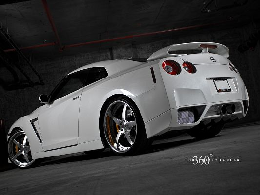 click to free download the wallpaper--Nissan Sport Car Wallpaper, White and Decent Car About to Turn a Corner, Great in Look
