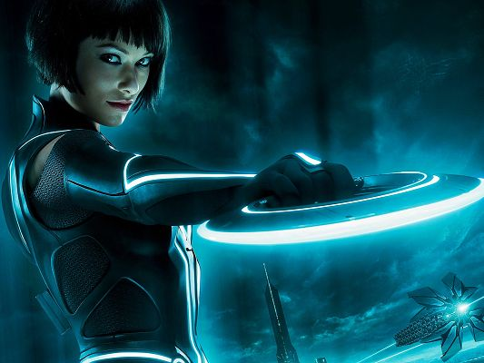 Olivia Wilde Tron Legacy 2010 Post in 1600x1200 Pixel, Girl with Her Tough Weapon and Sharp Eyes, She Shall Fit Various Weapons - TV & Movies Post