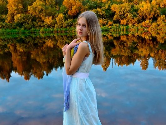 Photos of Cute Girl, Beautiful Girl by the Peaceful Lake, Golden Tall Trees Reflection