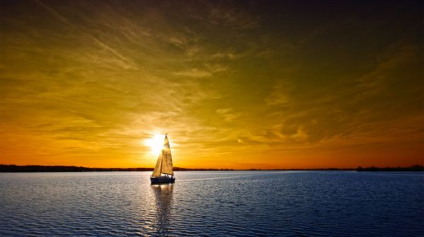 click to free download the wallpaper--Pics of Natural Scene - The Golden Sky, a Sailing Boat on the Peaceful Sea, Combine a Great Scene!