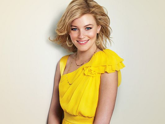Played in Role Models, The Uninvited and The Next Three Days, In Smiling Facial Expression and Yellow Suit, What a Star! - HD Elizabeth Banks Wallpaper