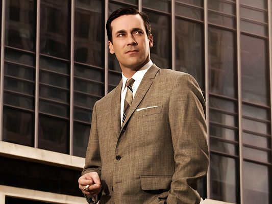 click to free download the wallpaper--Played in The Town and AMC's Mad Men, Looks Handsome and Successful, Well Worthy of Young Girl's Chase - Free Jon Hamm Wallpaper