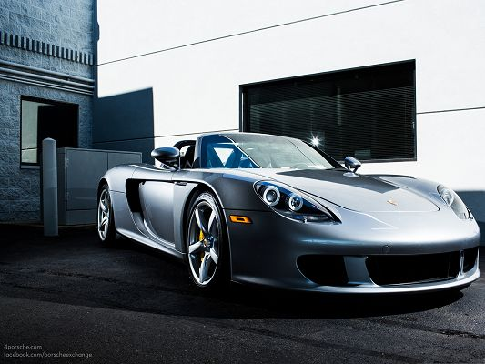 click to free download the wallpaper--Porsche Carrera GT as Wallpaper, Convertible Super Car, Added Glowing Effect