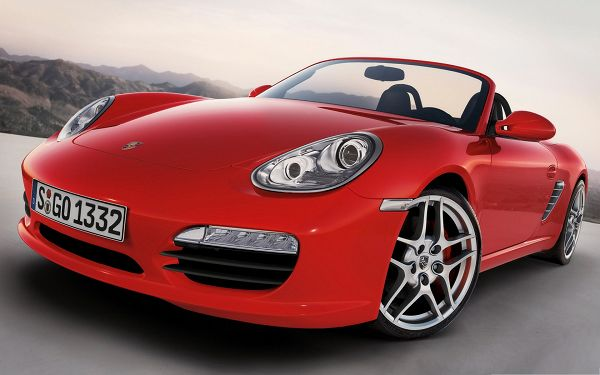 click to free download the wallpaper--Porsche G3 Car Wallpaper, Red Super Car About to Turn a Corner, Great in Look