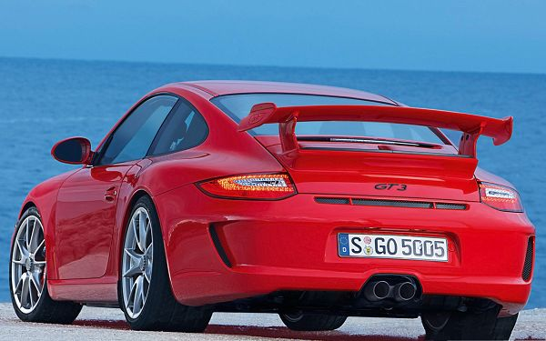 click to free download the wallpaper--Porsche G3 Car as Background, Red Super Car Driving Toward the Sea, Amazing Look