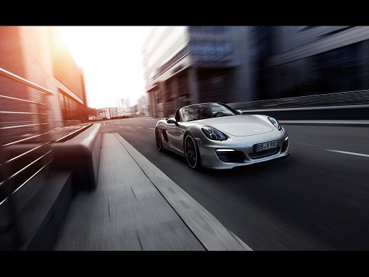 click to free download the wallpaper--Post of Super Cars, Porsche Boxster on the Road, is Decent and Prosperous in Look