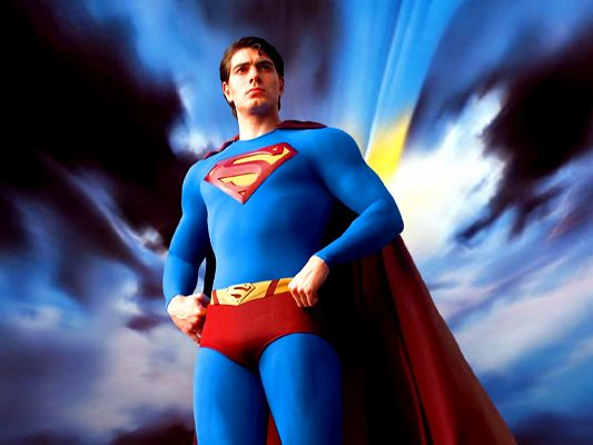 click to free download the wallpaper--Poster of TV & Movies, Superman Standing Under the Sky, Both Blue, They Are the Same